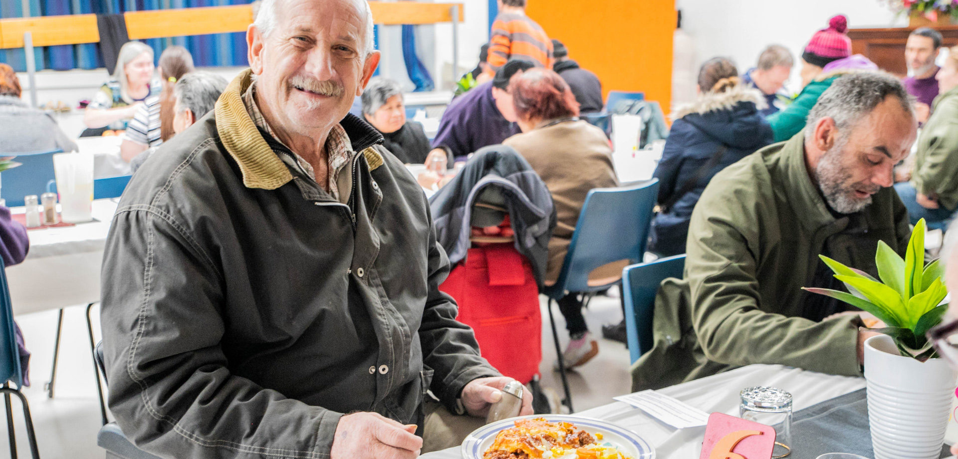 A warm, nutritious meal and friendly smiles for those who are socially isolated.